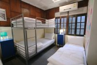 hostel room with bunk beds at club one seven