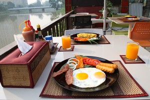 Breakfast beside the river at Club one Seven